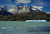 Beyond the waves upon the glacial milk/flour water of Lago Grey, to a blocky iceberg - over the rocky and vegetated peninsula - to Cuernos del Paine (c), with La Hoja and La Espada adjacent - to Mt. Almirante Nieto (distal, r), and Cerro Fortaleza (distal, l).