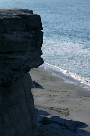 From the sea cliff ledge - down about 130 ft. (43 m) - to the wave breaking upon the northern shoreline of Bahia Moreno.