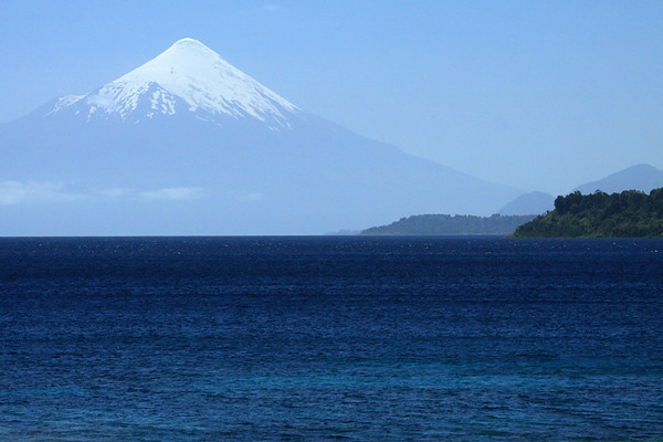Across Lago Llanquihue - beyond the lower slopes of Cerro Pichijuan - to the glacier capped, Volcan Osorno.