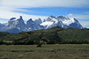 Across the Patagonia Steppe ecoregion terrain - to the Horns of Paine (l) - Torres Sur and Central (distal, c) - and Cerro Almirante Nieto (r).