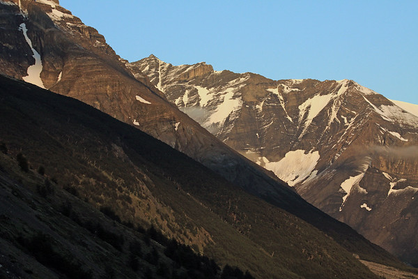 Morning light upon the lenga forest, along the slope of Cerro Almirante Nieto - to the snow patches along the slope of Cerro Nido Condor - then beyond the clouds, to the distal Cerro Oggioni - Torres del Paine Natonal Park.