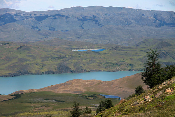 From the southern beech trees along the lower eastern slope of Mt. Almirante Nieto - down to glacial water of Lago Nordenskjold - back up to Laguna Larga (an endorheic lagoon) - and distally to the snow-patched ridge of Cerro Toro, along the horizon with the cumulus clouds.