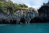 Beyond the glacial milk water of Lago Carrera - to the water sculpted marble column and overhang.