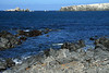 Beyond the rocky shoreline to the southern end of Isla Santa Maria, and the sea stacks beyond - Antofagasta region.