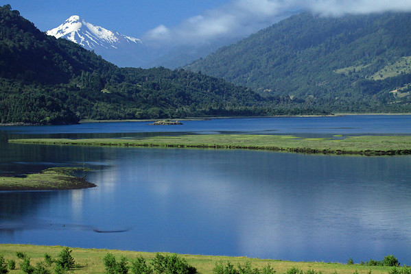 Mouth of  the Rio Petrohue - into the northern end of the Reloncavi Fjord (the northern most fjord in South America) - across the steep forested slope and peninsula (l) - to the distal glaciated Volcan Yate.
