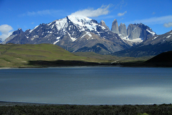 Across the cloud-shaded Laguna Amarga, beyond the patches of southern beech trees, at the southeastern mouth of Valle Asencio - to Mt. Almirante Nieto (c), with the peak of Cerro Paine Chico Sur in the clouds - Cuerno Principal (l), main horn - and the Paine Towers (r), with the adjacent hornfels-capped Cerro Nido Condor.