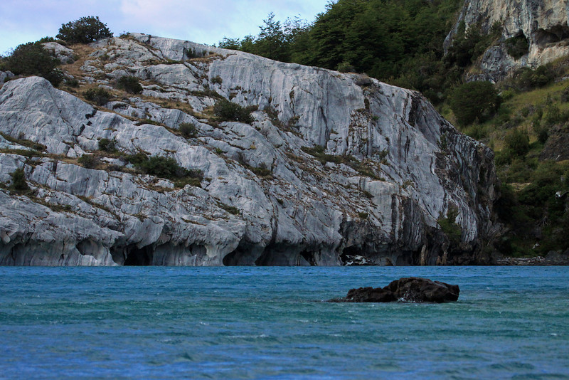 Sea caves eroded into the marble shoreline, of Lago Carrera.