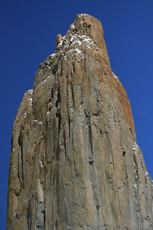 Torre Central - the intrusive/plutonic igneous granite spire and summit, sculpted from the Last Glacial Maximum (about 20,000 yrs. ago, when the southern 1/3 of Chile was completely covered with ice, from about 41° S) - today its continues its slow exterior transformation, but now by frost-wedging.