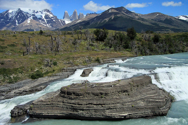 Paine River Waterfall - to the distal Towers of Paine - Torre Sur (l), with the glacier below - Torre Central, adjacent to the twin peaks of Torre Norte - the the summit and lower ridge of Cerro Nido Condor (r) - with a glimpse of Cerro Fortaleza (distal between Sur and Central) - in the foreground is Cerro Paine (r) and the glacial ice slopes of Mt. Almirante Nieto (r).
