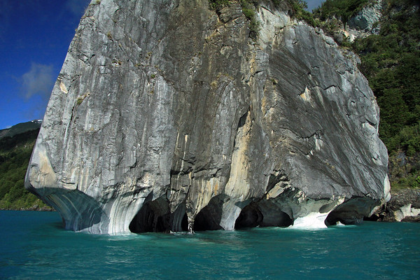 Beyond the glacial water of Lago Carrera - to the wave eroded overhangs, sea caves, and arches of Catedral de Marmol.