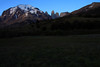 From the shaded grassland and endorheic lagoon, across the southern beech trees scattered along the southern slope of Cerro Paine - to the early morning sunlight upon the glacial ice, upon Mt. Almirante Nieto - and beyond to the distal Cerro Nido Condor (r), next the twin peaks of Torre Norte and adjacent Torre Central - with Torre Sur (l), and the distal summit of Cerro Fortaleza beyond.
