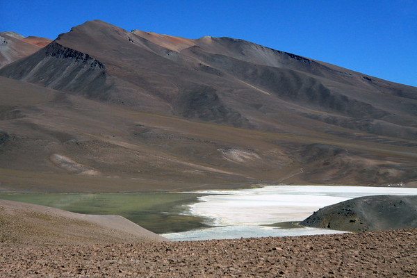 Across Laguna Santa Rosa and the Salar de Maricunga - viewing up the southeastern slopes and ridges of Cerro Maricunga - Nevado Tres Cruces National Park.