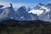 Across the rocky and vegetated slope - to the Horns of Paine (Norte, Principal, and Este) - distal peaks of Torres Sur and Torres Central - and Mt. Almirante Nieto (r).