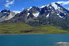 Across Lago Nordenskjold, and the cushion plant clustered slope - to the forested lower slope of Mt. Almirante Nieto - with the Horns of Paine (l), and slight glimpse of the peak of La  Mascara.