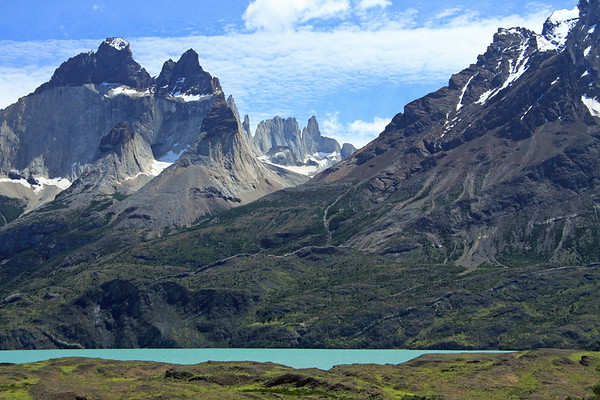 Beyond the glacial flour/milk water of Lago Nordenskjold - to the igneous dikes (sheet intrusions) along the lower slope of Mt. Almirante Nieto (r) - across the mouth of Valle Bader, to Cuerno Este and Cuerno Principal (l) - and distal (c), to La Mascara (mask), La Hoja (blade), and La Espada (sword).