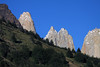 Along the northern slope of Mt. Almirante Nieto - to the early morning sunlit igneous granite spire of Torre Central (l), Torre Norte (c), and Cerro Nido Condor (r).