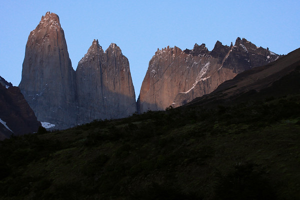 Early morning across the slope of Cerro Paine - to northern slope of Mt. Almirante Nieto (l) - eastern view of Cerro Nido Condor (r) - and adjacent to the twin peak of Torre Norte and granite spire of Torre Central.