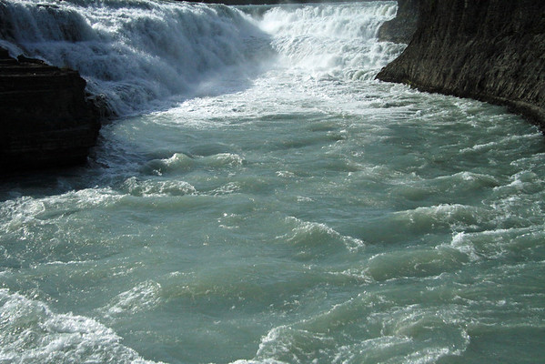 The glacial milk water flowing from the cascade of the Paine River Waterfall.