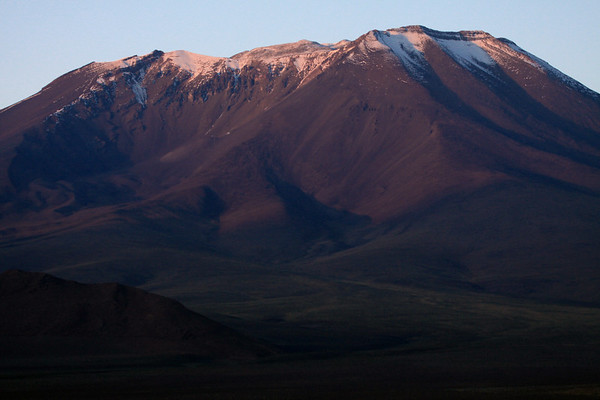 Day's first rays upon the snow-cloaked crater rim of Cerro Palpana.