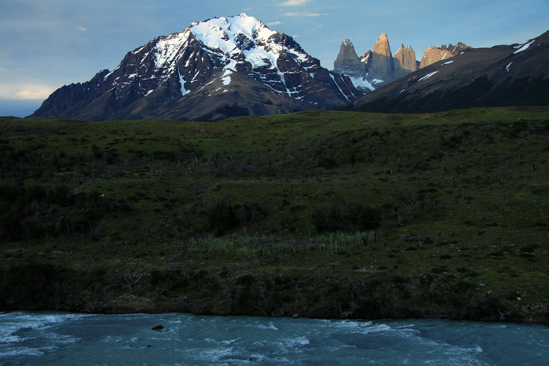 From the glacial milk water of the Rio Paine - to the lower shaded slope of Cerro Paine (r), displaying its Lenga forest - to the sunlit hanging glaciers upon the slope, up to the summit of Mt. Almirante Nieto (l) - to the slightly sunlit peak of Torre Sur, with the shaded glacier below, and the Cerro Fortaleza beyond - Torre Central, and the adjacent twin peaks of Torre Norte - Cerro Nido Condor.