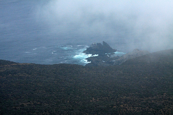 Pacific waves breaking upon the peaked sea stacks - along the lower western slope of the Cordillera Talinay.