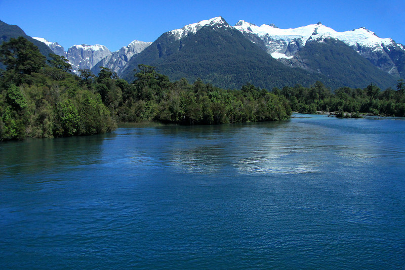 Across the Rio Yelcho and vegetation of the Valdavian Temperate Rainforest - to the Cerro Cascada and Morro Hornos (r) - up the valley to the glacial sculpted intrusive igneous rock of Cerro Sombrro - Corcovado National Park.