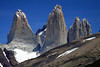 Beyond the foreground slopes of Cerro Paine (r) and Mt. Almirante Nieto (l) - to the Torres del Paine - Torre Sur (l), also known as D'Agostini, peaking at around  9,350 ft. (2,850 m) - Cerro Central rising up to about 9,186 ft. (2,800 m) - and the twin peaks of Cerro Norte (r), also called Monzino, topping in at near  7,375 ft. (2,248 m)  - with the distal glimpse of the metamorphic hornfels caprock upon Cerro Fortaleza.