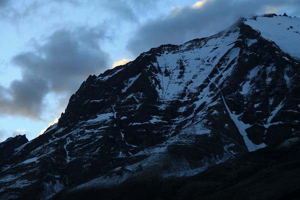 Up the eastern face of Mt. Almirante Nieto - with the sunset light striking the clouds above.