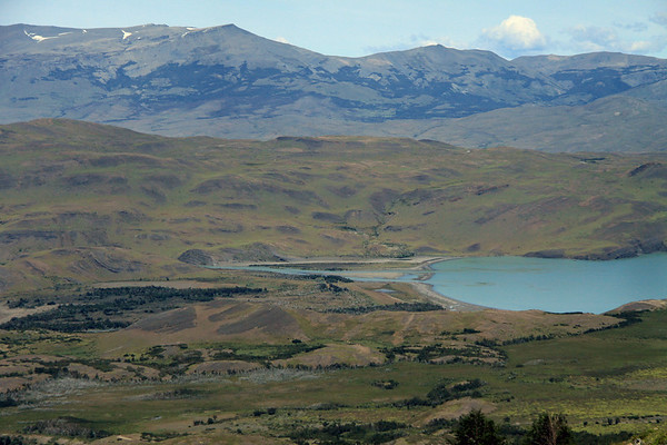Down from the eastern slope of Mt. Almirante Nieto - to the mouth of the Rio Paine, into the northeastern end of Lago Nordenskjold - with Rio Asencio, slightly seen (lower, l) - and the distal slope of Cerro Toro, along the distal horizon.