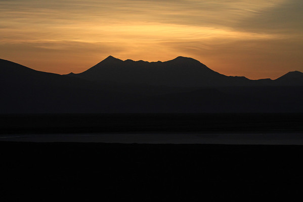 Near sunrise beyond Cerro Tapaquilcha, Potosi department of Bolivia - with the northeastern Salar Ascotan along the foreground, northern Antofagasta region of Chile.