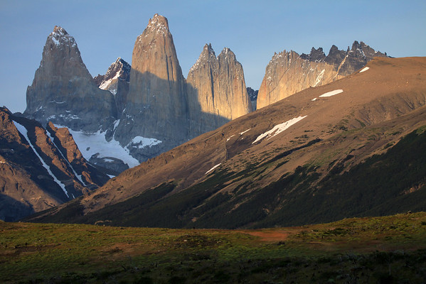 Morning sunlight upon the cushion plants  - to the Lenga Beech forest along the lower slope of Cerro Paine - across the Valle Asencio, to the glacial ice streams upon the slope of Mt. Almirante Nieto - to the Torre Sur, the glacier below, and Cerro Fortaleza beyond - Torre Central, and twin peaks of Torre Norte - the distal shaded Cerro Escucio - and the sunlit jagged granite peak and lower hornfels ridge, of Cerro Nido Condor.