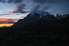 Sunset glow upon the stratus clouds, above the distal Cerro Ferrier - about 10:20  on Dec. 31, and the apparent sunset at about 10:10 - with the glacial ice cap upon Mt. Almirante Nieto (c) - and the Torres del Paine (r), adjacent Cerro Nido Condor.