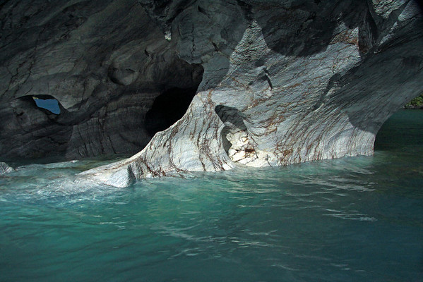 Sunlight and shadows upon the water sculpted metamorphic marble of the Capillas de Marmol (Marble Chapel).