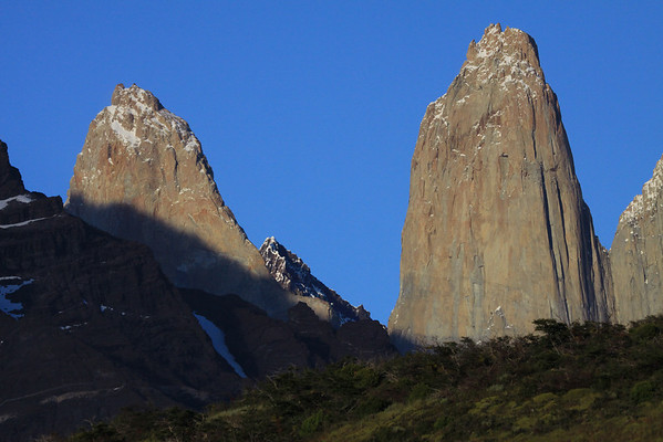 From the cushion plants, shrubs, and southern beech tree upon the lower slope of Cerro Paine - to the northern slope of Mt. Almirante Nieto (l) - beyond to the shadow of Mt. Almirante Nieto, upon the igneous granite of Torre Sur, then beyond its northern buttress to the metamorphic rock cap and summit of Cerro Fortaleza - then back to the Torre Central, and col Bich (the notch or gap) separating it from the adjacent, Torre Norte.