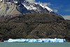 Lago Grey - blocky iceberg - across a peninsula, to the southern slope of Cuernos Principal, displaying the fusion of metamorphic (top) and igneous rock - Paine Massif (or Cordillera Paine).