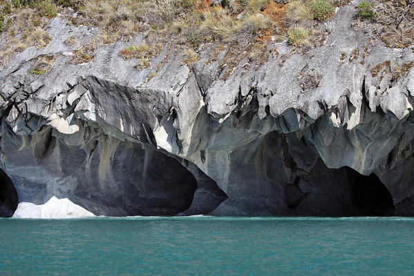 Sunlight and shadows along the water sculpted marble sea caves - along the western shoreline, of Lago Carrera.