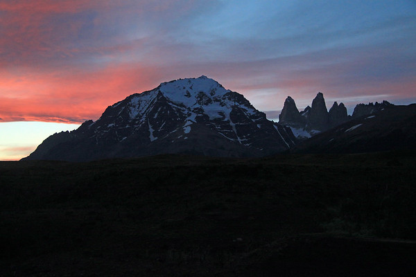 Shortly after the apparent sunset - with the glow upon the Paine Massif or Cordillera Pain - the glacial ice cap of Almirante Nieto - Towers of Paine - Cerro Fortaleza, distal between Torres Sur and Central - Cerro Escucio, distal between the twin peaks of Torre Norte and Cerro Nido Condor.