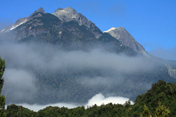 Beyond the cumulus cloud - above the timber-line, to the igneous rock peaks, upon Volcan Calbuco.