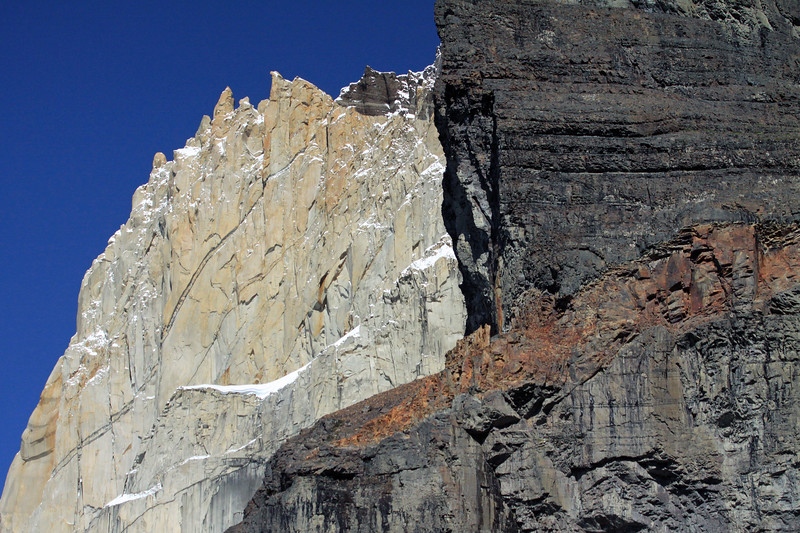 Beyond the metamorphic rock (displaying a patch of iron oxide, hematite) - to the intrusive/plutonic igneous granite rock above, displaying a metamorphic cap - both part of Cerro Nido Condor.