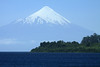 Beyond the thick vegetation upon a peninsula, along the lower slope of Cerro Pichijuan - across Lago Llanquihue - to the distal glacial ice, atop the active Osorno Volcano.