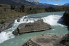 Northwestward view of the Casdada del Rio Paine (Paine River Waterfall) - which forms both a cascade and chute falls - from the early summer season glacial and snow melt water.