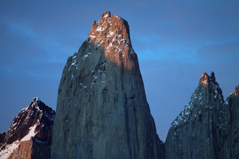 Day's first rays upon the glacial sculpted, plutonic igneous granite spire, of Torre Central - and the adjacent (attached by the col Bich), twin peaks of Torre Norte - and the distal metamorphic cap rock of Cerro Fortaleza.
