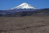 Snow-cloaked slopes and peak, of Volcan Patos, also known as Volcan Tres Quebradas - rising to about 20,469 ft. (6,239 m) - and whose peak marks the border from here in the Atacama region of Chile, with the Catamarca province of Argentina.