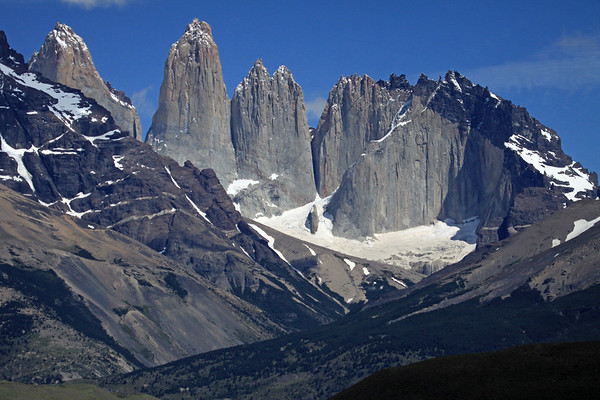 Along the slopes of the Asencio Valley, patched with southern beech trees - with the lower eastern slopes of Mt. Almirante Nieto (l) - and beyond to the granite spires of Torres del Paine, adjacent to the hornfels-capped  metamorphic rock of Cerro Nido Condor (condor nest).