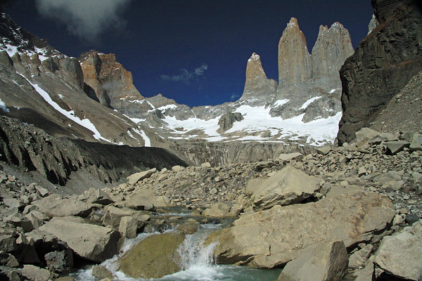 Glacial water flowing from a lagoon at the base of the Towers of Paine (r), and the glacier below - with the upper slopes and ridges of western Mt. Almirante Nieto (l) - Cerro Nido Condor (r) and Hoya (distal, c).