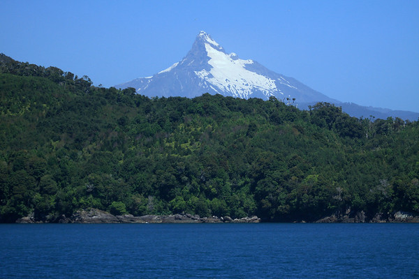 From the Chaiten Cove, the Pacific Ocean - across the rocky shoreline and forested slope of Isla Puduguapi - to the Volcan Corcovado.