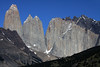 Beyond the slope of Cerro Paine (r), displaying southern beech trees - to the distal northern slope of Mt. Almirante Nieto, revealing clusters of southern beech along the lower elevation - to the distal Torre Central, and attached twin peaks of Torre Norte - and the jagged granite peak, and lower hornfels ridge of Cerro Nido Condor.