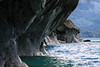 Into a marble sea cave along the western shoreline of Lago Carrera - viewing northeastward, across one of the rocky and forested islands of the Islas Malvinas - to the distal steep slope of the Patagonia Andes.