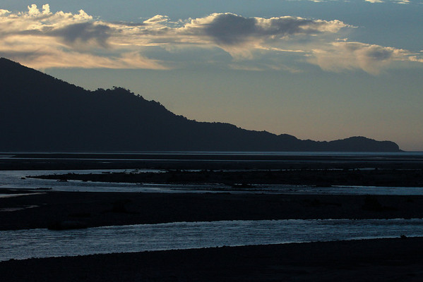 Sunset light upon the alluvial plain of the Rio Yelcho - to the northwestern lower slope of Volcan Corcovado, ending at Punta Auchemo and the Pacific Ocean - with  the cumulus clouds above.
