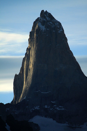 Near apparent sunset light upon the southern granite face of Torre Sur- with the glacial ice at its base.
